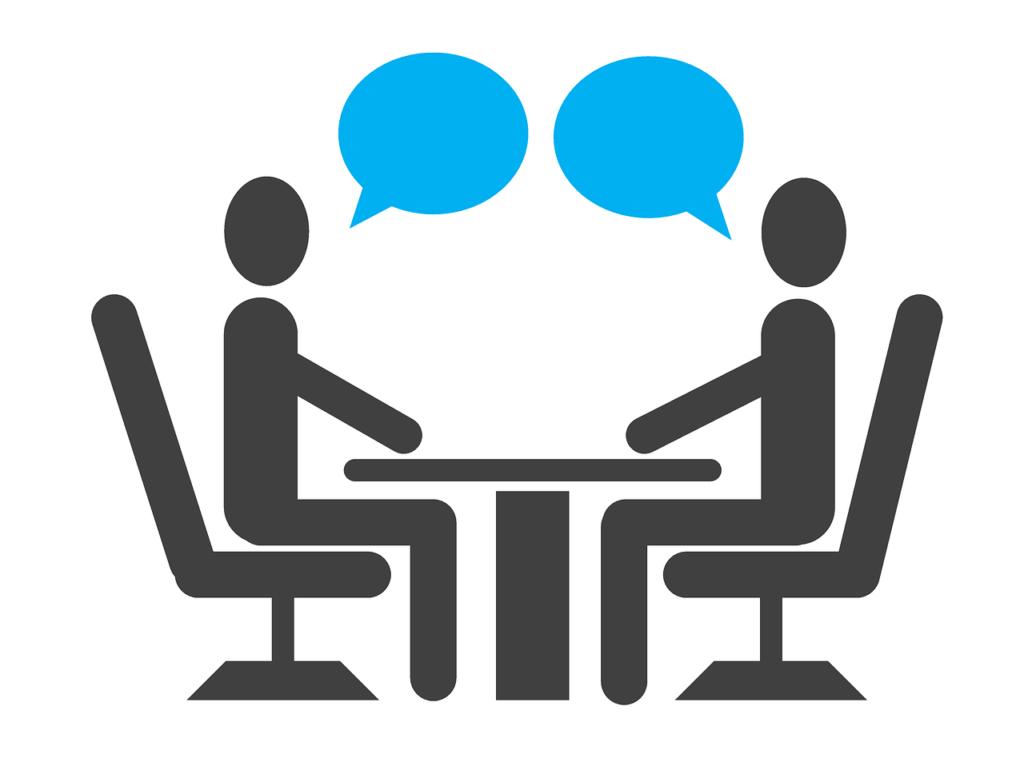 テーブルを挟んで会話する二人のイラスト